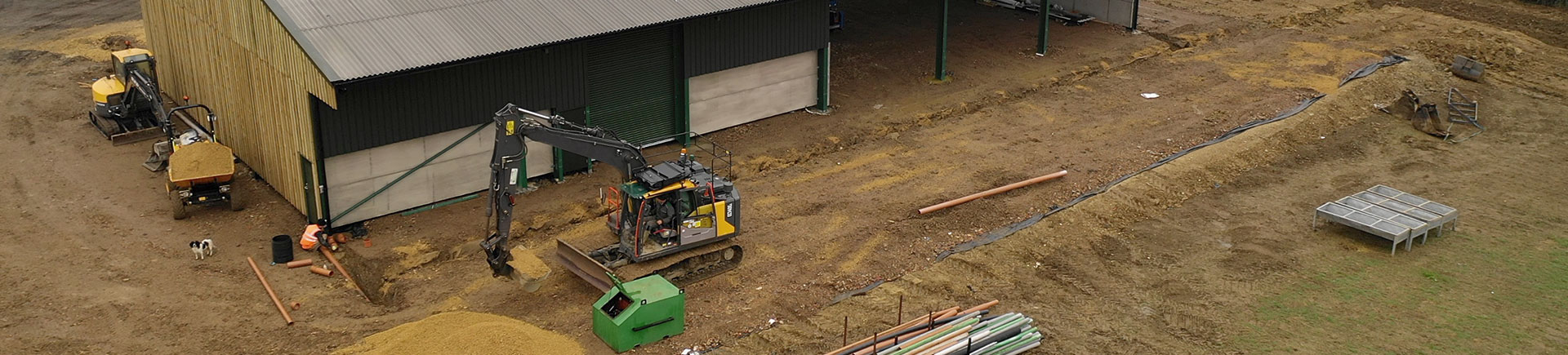 A diversified farm project with a digger working outside which is all insured with Acres Insurance Brokers